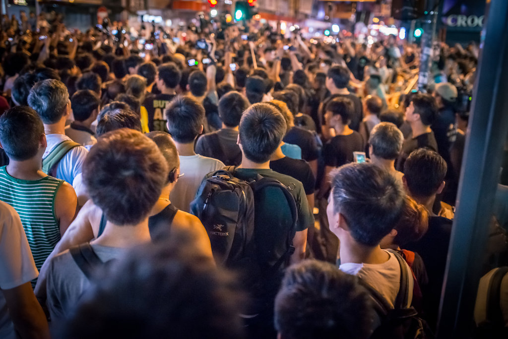 Crowd stares at an argument at Occupy Central